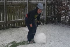 Toby Rolling a Snowball