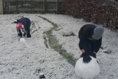Toby and Zara Rolling Snowballs