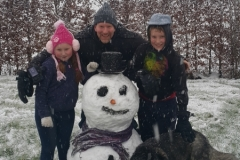 James, Toby, Zara and Alaska posing with the Snowman